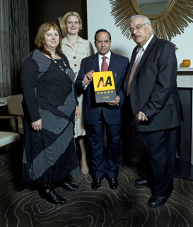 Giovanna Grossi, from the AA presented the award to  Sabine Altschaeffl GM, Ramesh Arora MD & Shiraz Lalji Chairman of The Montcalm