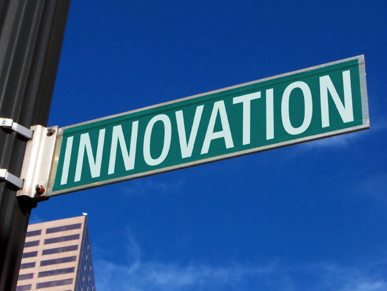 A street sign with the word Innovcation on it.