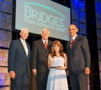 L to R: Foundation Chairman Richard Marriott, Texas Congressman Pete Sessions and NFL legend and author Tony Dungy honor Maria Gomez for her outstanding achievements at the 2013 Bridges From School to Work Annual Gala.