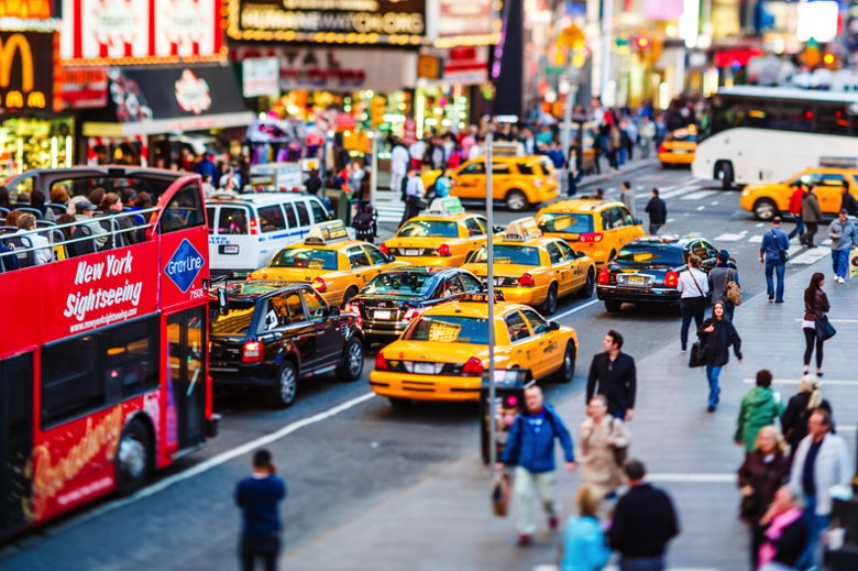 New York City, United States - May 10, 2012: Large group of taxis on 7th Avenue at Times Square in rush hour. Vast number of vehicles hit the streets and avenues of Manhattan every day. Almost half of