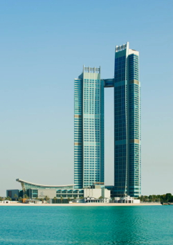 Exterior of The St. Regis Abu Dhabi with suspended 'Abu Dhabi Suite' between two towers.