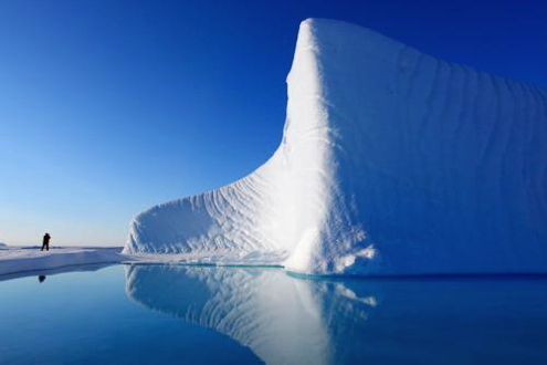 A pristine iceberg stands out starkly against Nunavut's blue skies.