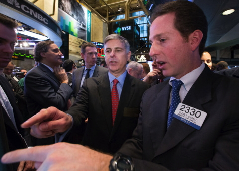 Hilton Worldwide President and Chief Executive Officer Christopher J. Nassetta in the center of the trading crowd as the company's stock opens for trading on the NYSE on Thursday, December 12. Traders wore Hilton Worldwide bathrobes. (Source: NYSE Euronext photo)
