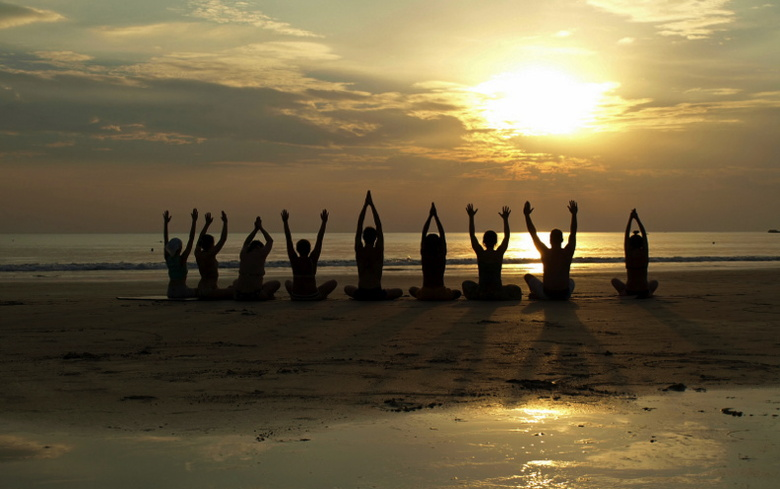 Yoga session on a beach