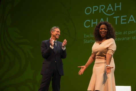 Howard Schultz and Oprah Winfrey on stage at Starbucks annual meeting