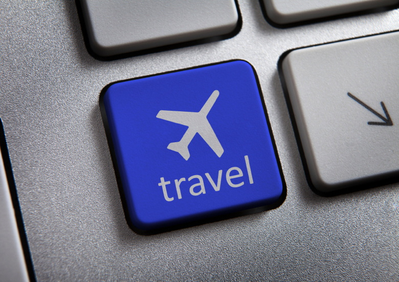 Plane icon on computer key. Travel concept.