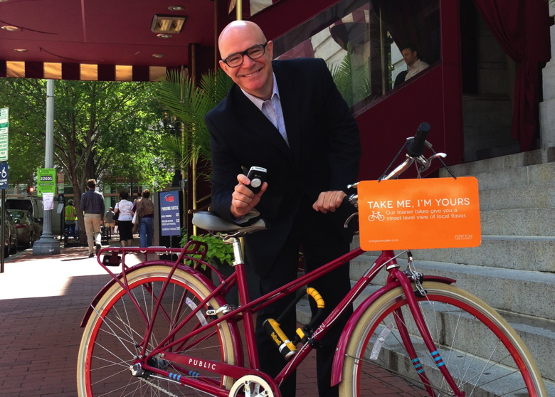 General Manager of the Monaco, Ed Virtue, pictured with a bicycle outside the hotel