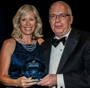Laura Osborne, President, HSMAI Greater New York Chapter presenting the President's Award to Thomas Travers, General Manager of the Beacon Hotel