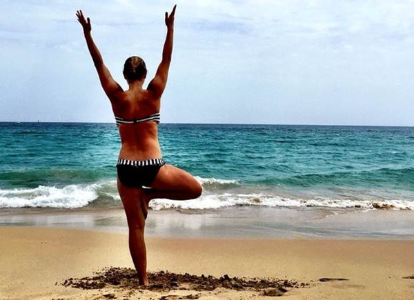 A woman exercising on a beach