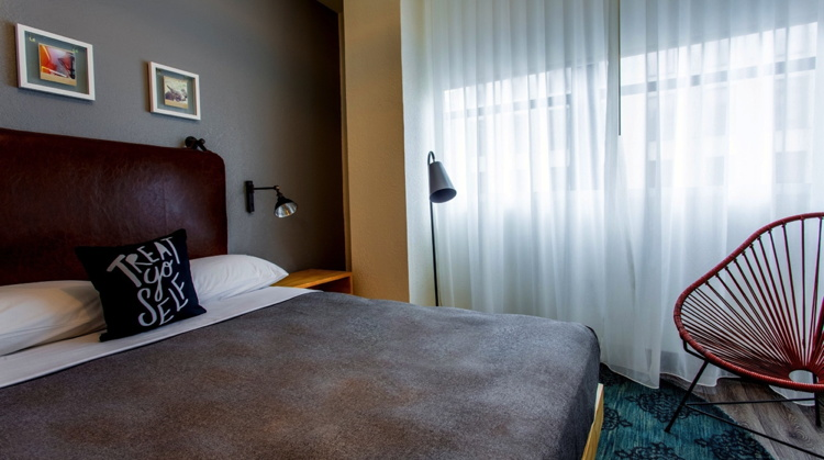 Guest room at the Moxy New Orleans Hotel