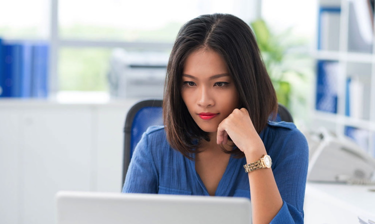 A woman in front of a computer