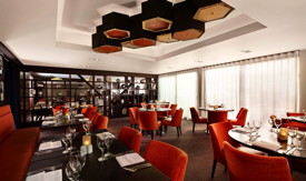 The hotel takes design inspiration from its natural surroundings using warm beiges and timber shades, with splashes of burnt orange hues to transform and create a modern look. Credit: DoubleTree by Hilton.