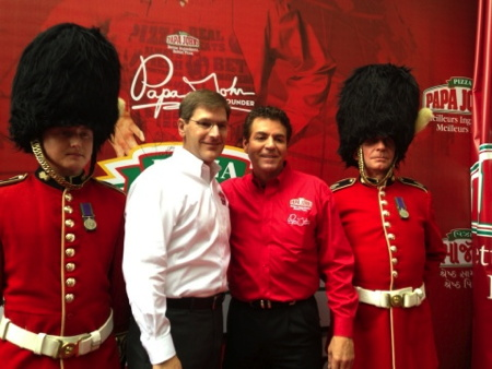 Papa John's founder, chairman, and CEO, John Schnatter, second from right, and Tony Thompson, Papa John's president and COO, celebrate the company reaching the 1,000 international restaurant milestone during a celebration in London.