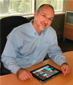 Warren Dehan with his Maestro iPad