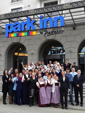 A group of employs in front of the Park Inn by Radisson in Sochi