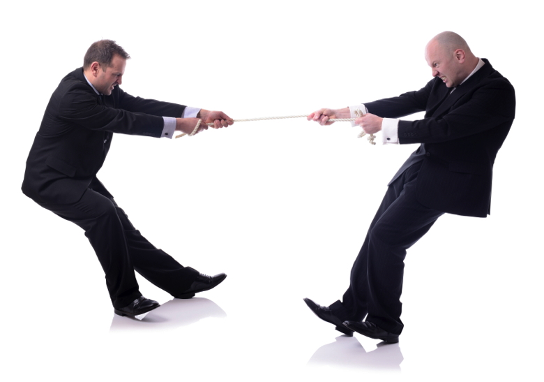 two businessmen in a tug of war isolated on white background