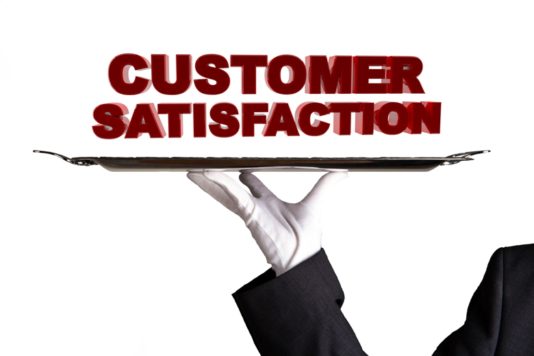 The word Customer Satisfaction on top of a serving tray