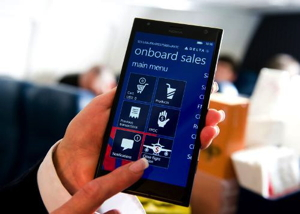 Delta flight attendant with a Nokia Lumia 1520 in her hand