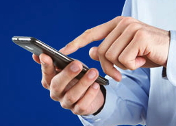From united.com - man holding mobile telephone in hand