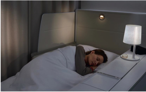 A woman sleeping in a Air France first class cabin