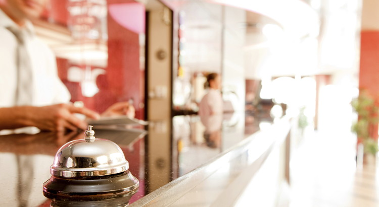A bell on a hotel reception desk - source European Cities Marketing