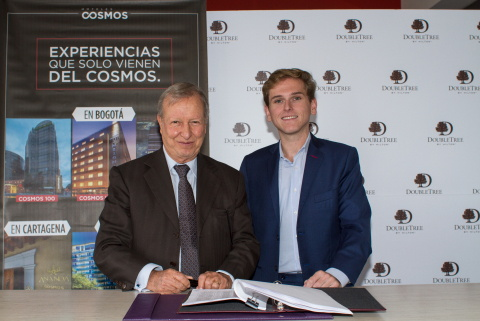 Richard Cajiao, Cosmos Group, and Juan Corvinos, Hilton Worldwide, sign agreement to open two DoubleTree by Hilton hotels in Bogota, Colombia.