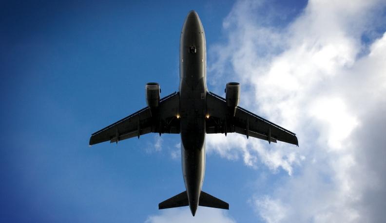 Photo taken underneath an airplane during landing