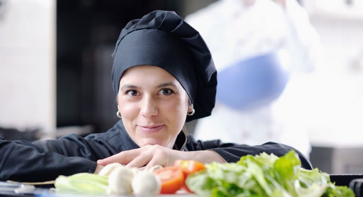 young chef woman prepare and decorating food in kitchen