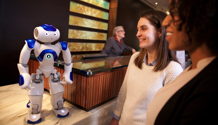 A robot at a hotel concierge desk