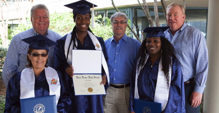 Ed Williams, Jim Hyatt and Ed Brett with Stride for Success graduates Joann Jaso, Sherray Harley and Brittani Seymour