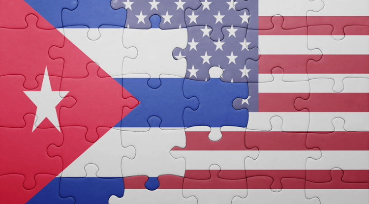 puzzle with the national flag of united states of america and cuba