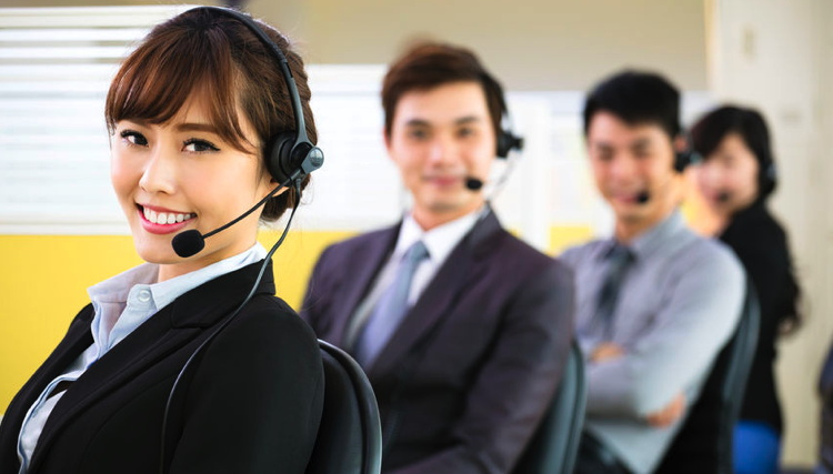 A group of people in a call center