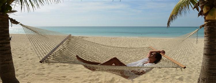 A woman in a hammock on a beach