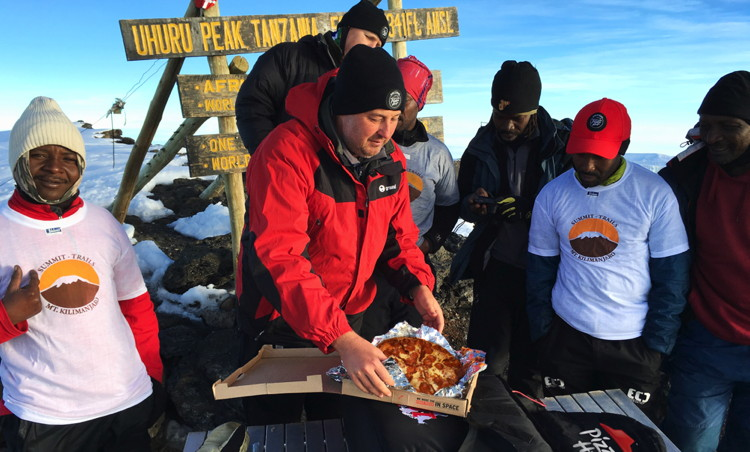 General Manager of Pizza Hut Africa, Randall Blackford, a team of Pizza Hut employees and several professional guides, hiked for six days to the top of Mt. Kilimanjaro to set the Guinness World Record