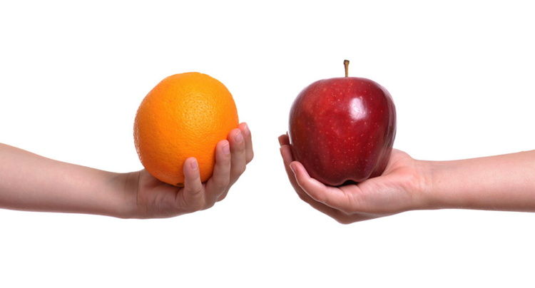 Two hands with an apple oand orange