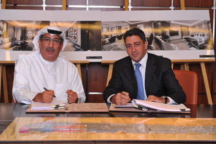 Waleed Alsharian, Chief Executive Officer of Mabanee Company K.P.S.C (left), and Carlos Khneisser, Vice President Development ME & North Africa, Hilton Worldwide, sign the agreements for Conrad and Hilton Garden Inn hotels at The Avenues Mall, Kuwait: Conrad Hotels & Resorts.