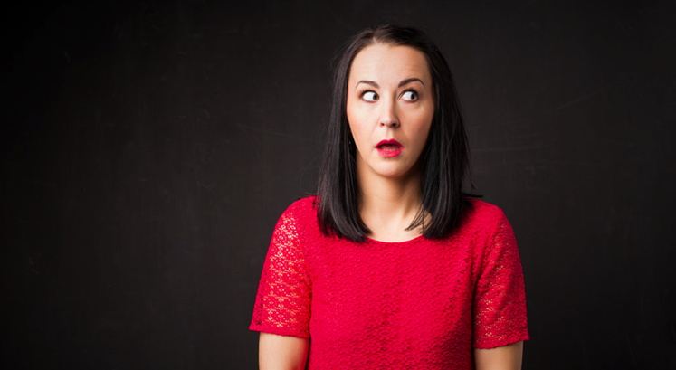 A woman with a surprised look on her face