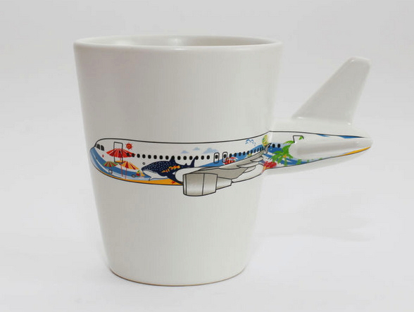 White cup with aircraft image on the light background