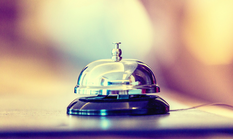 A service bell on a hotel desk