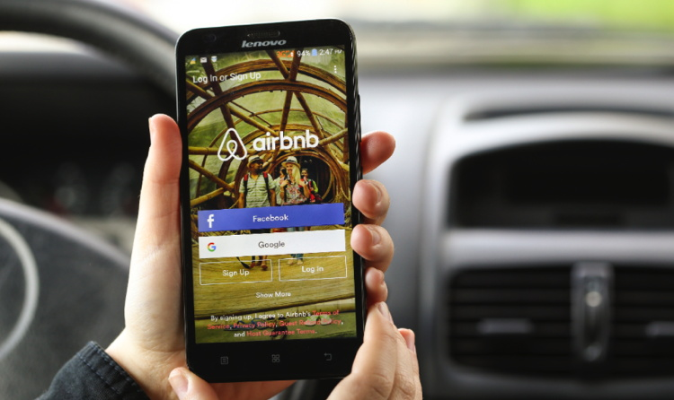 A smartphone with the Airbnb app open