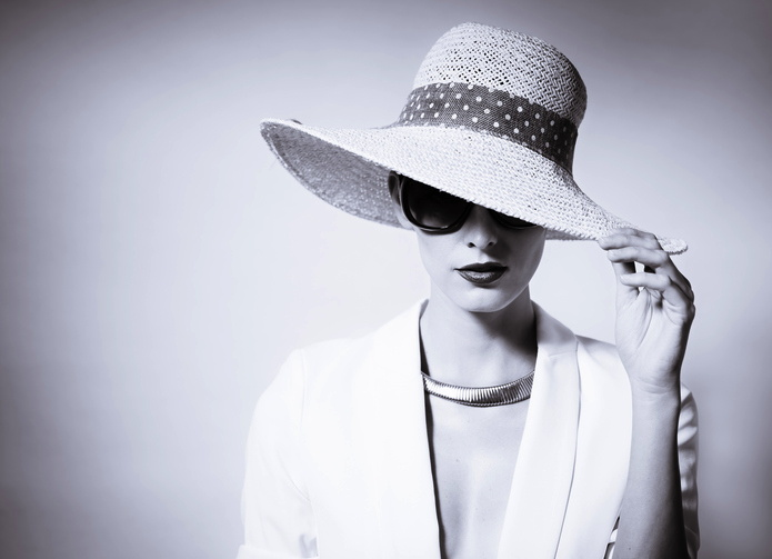 An elegant looking woman with a hat