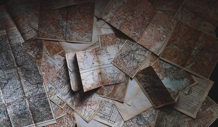 A table filled with Maps - Unsplash - Andrew Neel