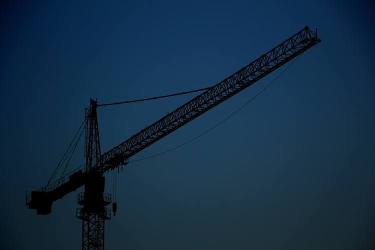 A construction crane - Unsplash