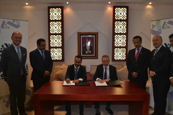 Representatives of Hilton Worldwide and the Muscat National Development and Investment Company.