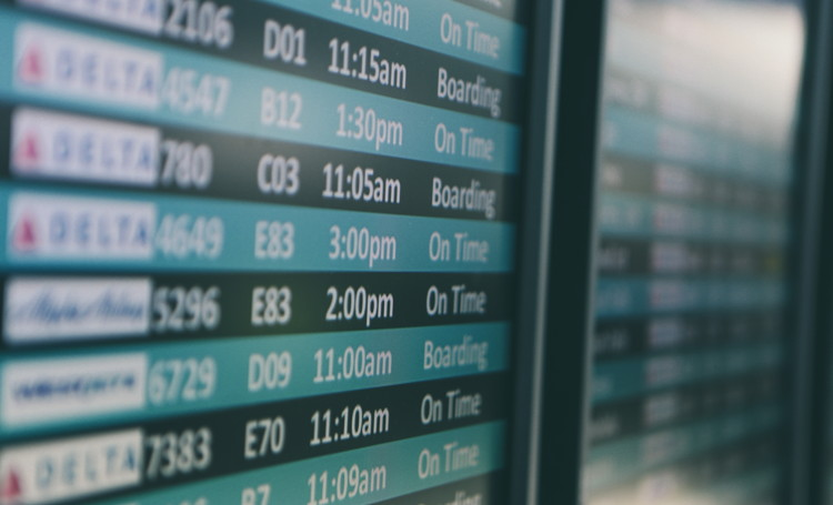 An airport flight board - Unsplash
