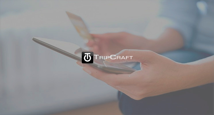A mobile phone and the TripCraft logo