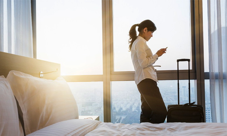 A woman using a smartphone in a hotel room