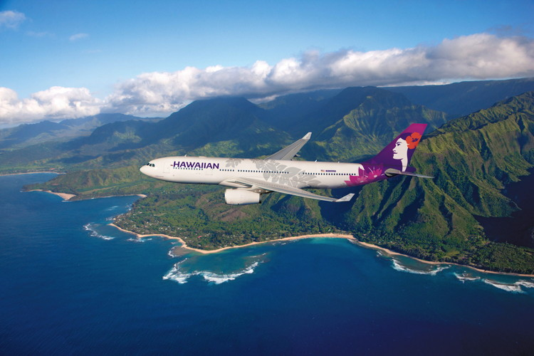 An airplane in flight with Hawaiian Airlines new livery