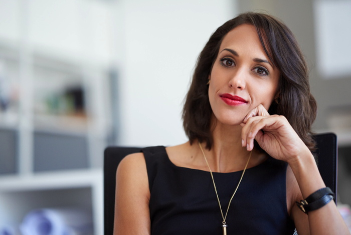 A female executive looking at the camera