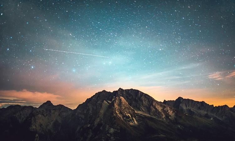 A night sky above a mountain range